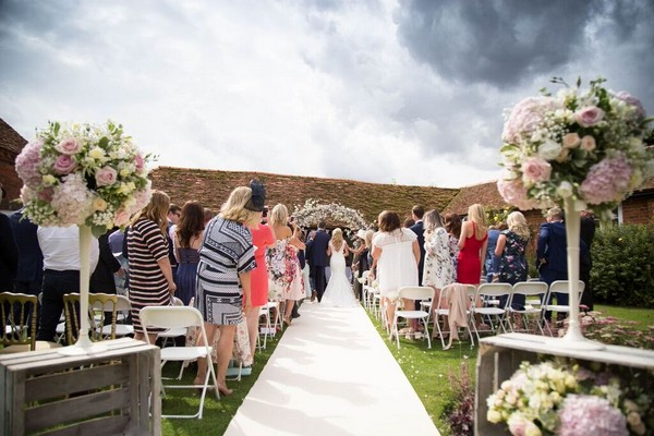 Outdoor Ceremony in the  Cloisters at Lillibrooke Manor