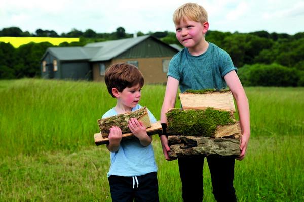 Children carrying logs