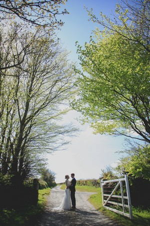 Country lane with married couple