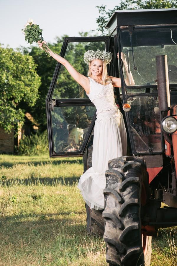 Bride posing on tractor