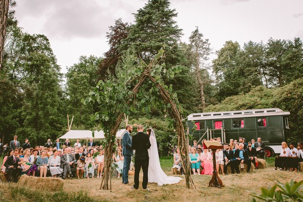 Couple under tree arch