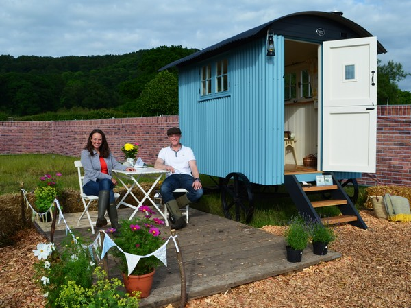 Outside blue glamping pod