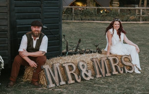 Mr and Mrs sign with married couple