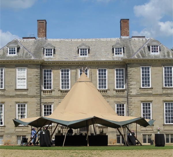Large tipi outside building