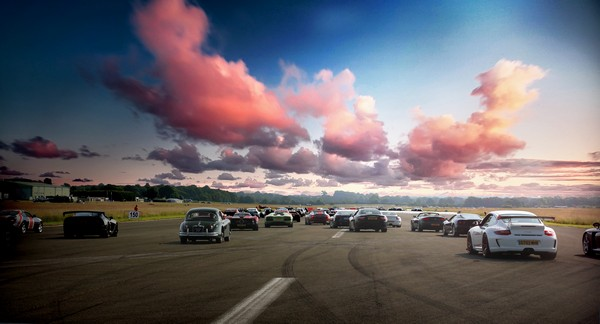 Racing cars, pink clouds