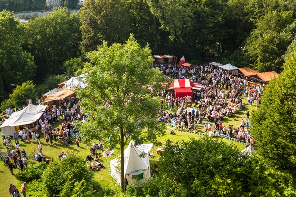 Festival outside with trees and marquees