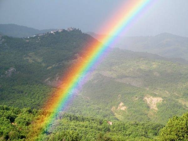 Rainbow over hills in Italy
