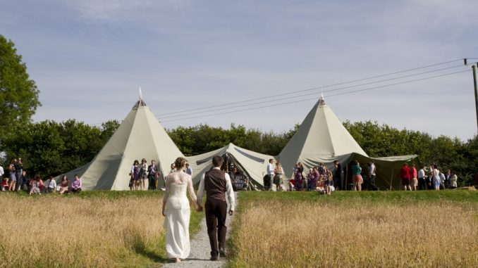 Outside wedding tipis