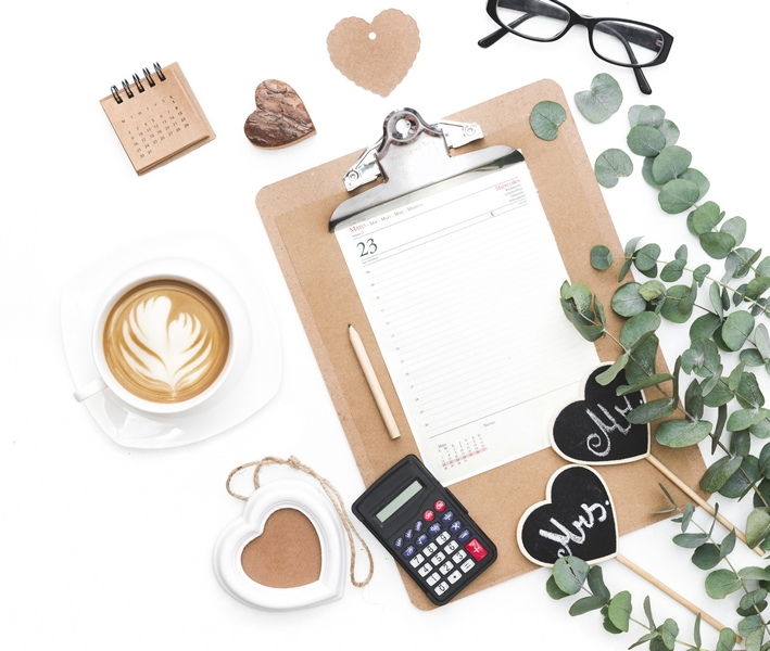 Clipboard with heart decoration and coffee