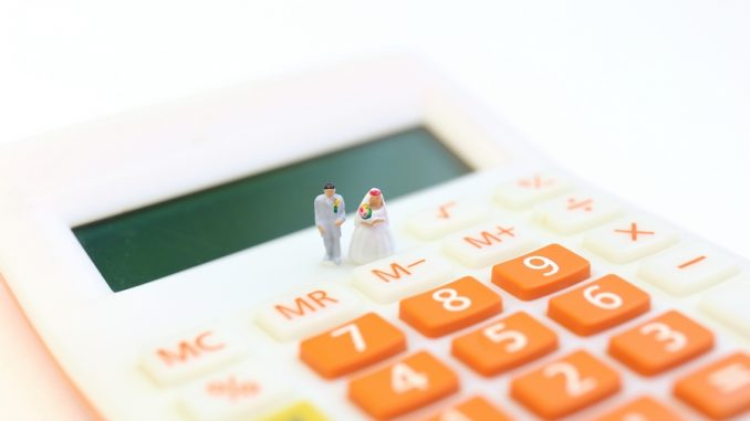 Wedding budgets calculator with small model of married couple