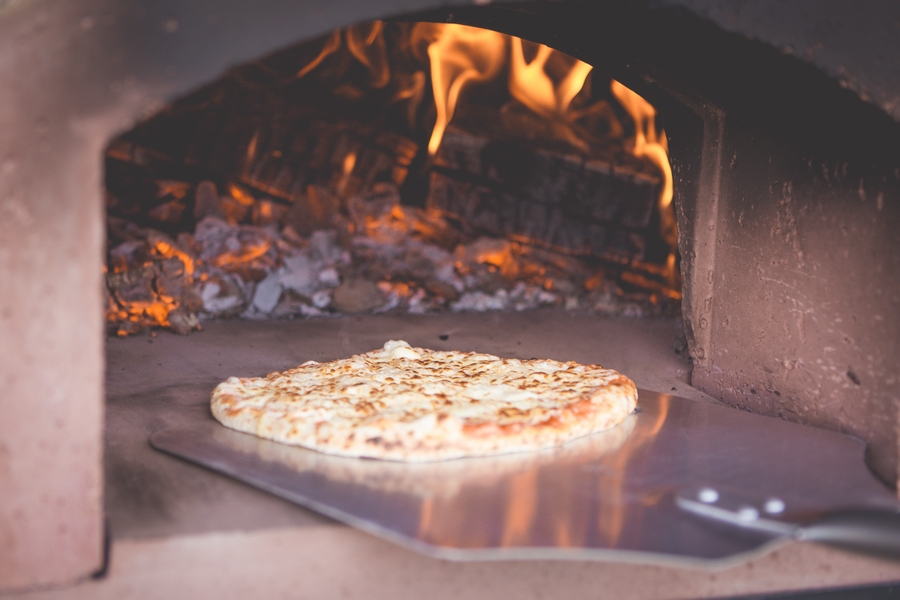 Cooking in fire oven