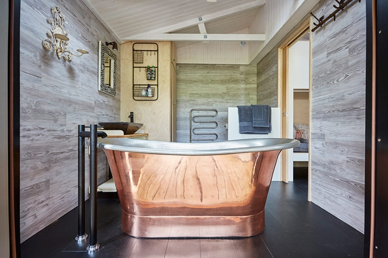 An industrial rustic look in the 'Cabin' at Brownscombe Luxury Glamping, Devon