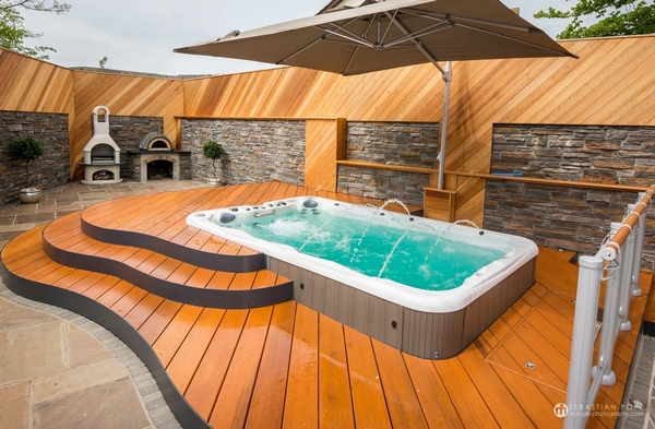 Hot tub with wooden flooring around