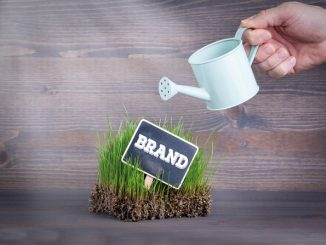 Watering can and sign saying 'brand'