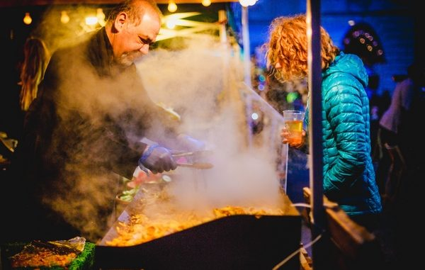 Chef cooking with fire at outdoor festival
