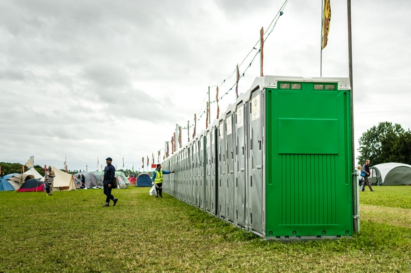 Large row of festival toilets