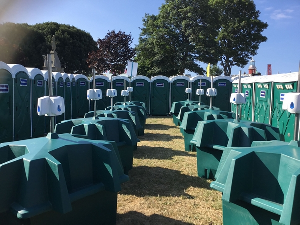 Portable toilets and urinals at an outdoor event