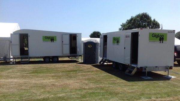 Mobile toilets and showers in a field
