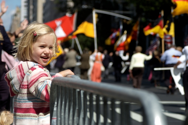 Child standing at event barrier