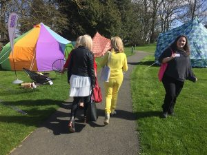 Visitors to OAB Gathering viewing bell tents