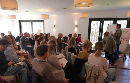 conference attendees at outdoor hospitality seminar