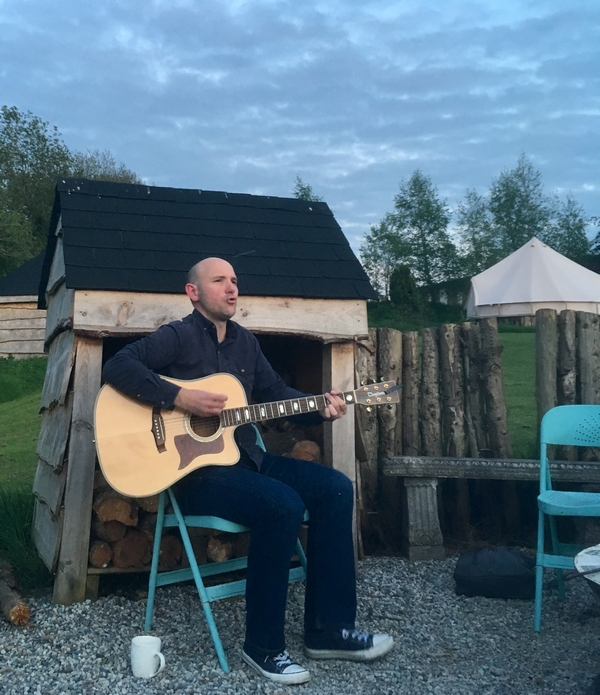 playing guitar at a glampsite