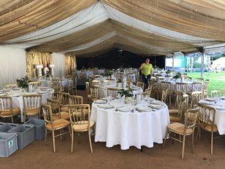 outdoor wedding reception inside a marquee