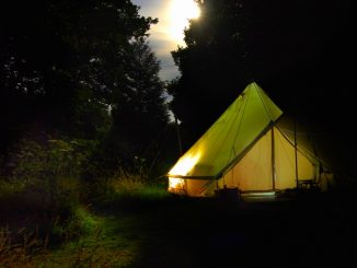 Glamping tent outside at dusk