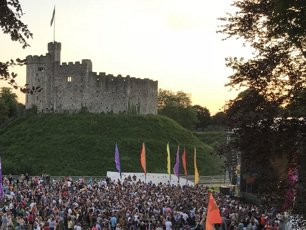 Crowd at festival by a castle