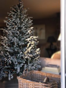 Fake snow-dusted Christmas tree