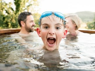 Child playing in hot tub