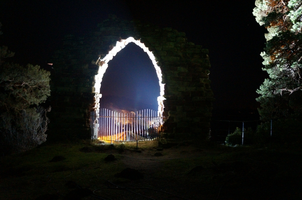 Archway lit up at night