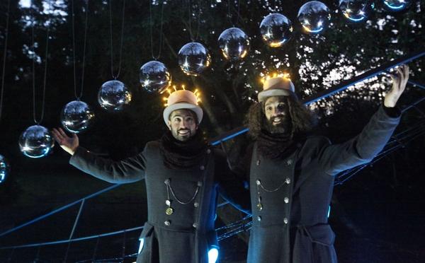 2 men in woodland light display