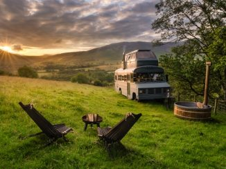 Campervan set up on hill at sunset