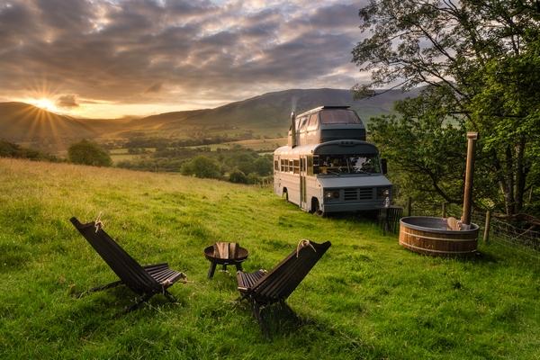 Campervan set up on hill at sunset