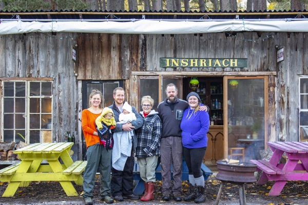 Family standing at Inshriach House