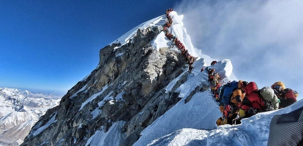 People queueing at the top of Mount Everest