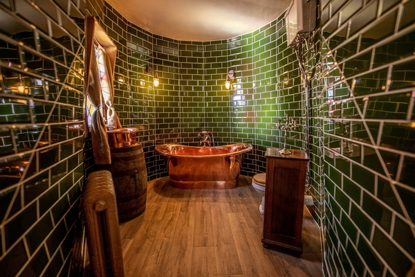 Green tiled bathroom in the North Shire holiday home
