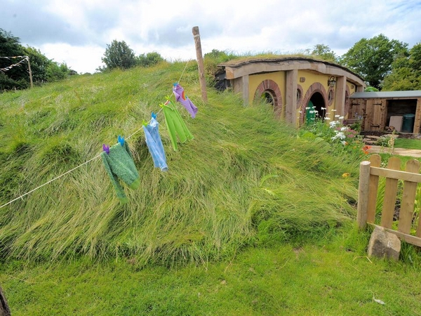 North Shire hut built into grass mound with washing line