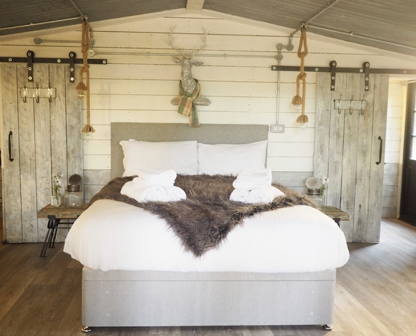 Bedroom with sheepskin throw on the bed