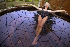 Woman relaxing in ecoYoga hot tub