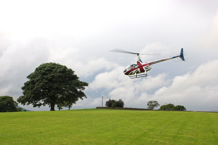 Helicopter arriving at Heaton House Farm