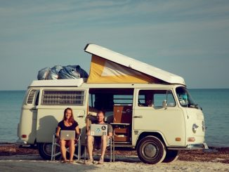 Couple holidaying with a campervan