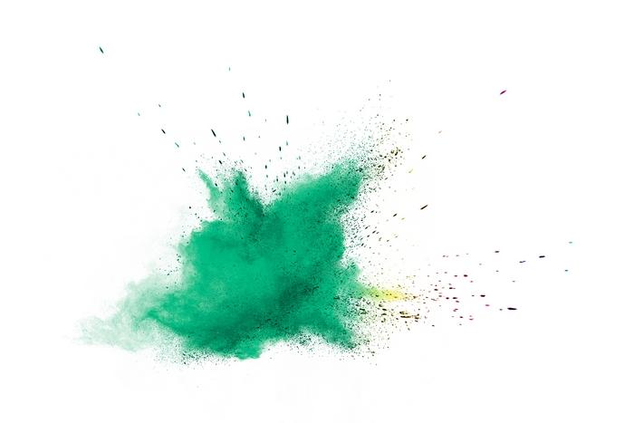 Green powder explosion on white background.
