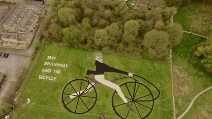 Man riding bike - land art