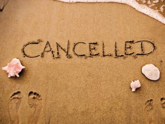 Cancelled written in the sand