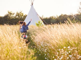 Girls running through a field
