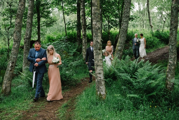 Comrie Croft wedding party walking through woods
