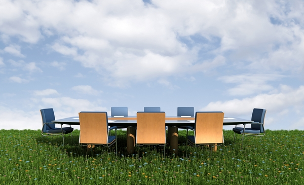 Business meeting set up in a field
