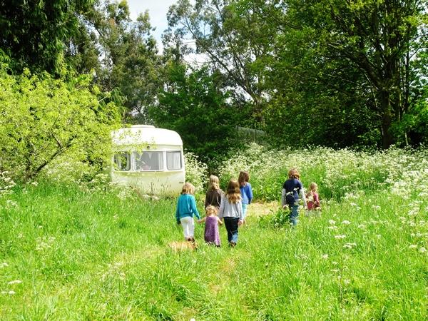 Children walking through a field